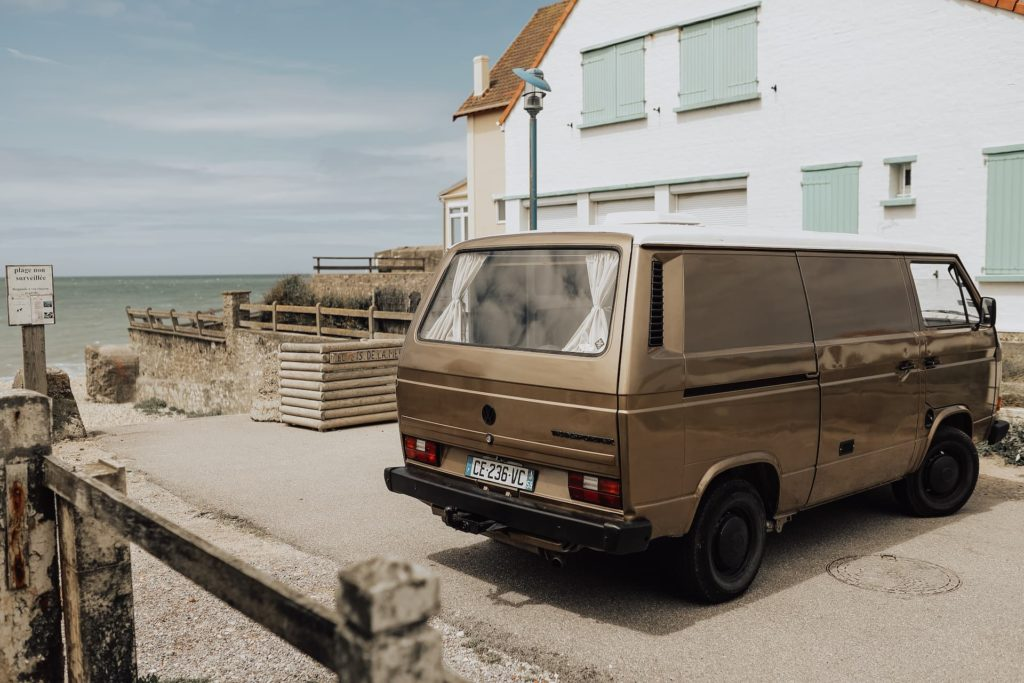 van from back on the beach